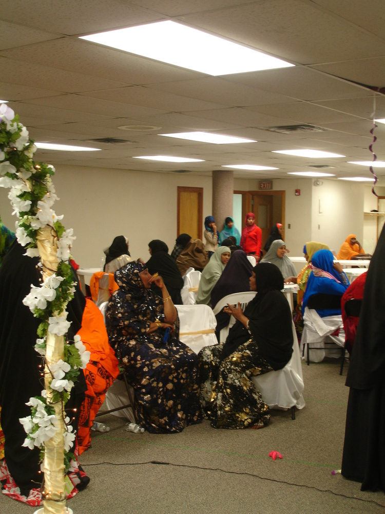 Photograph of women sitting at tables at wedding