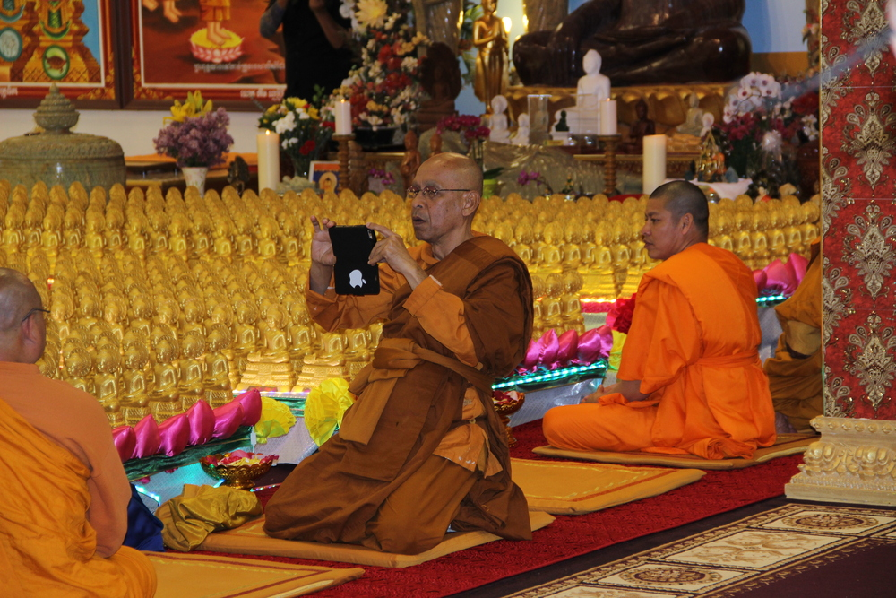 Monk Taking a Picture During Visakha Puja