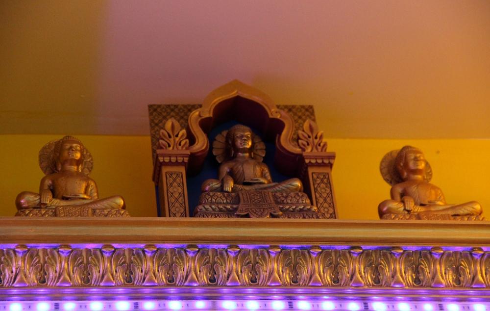 Painted Buddhas on Ledge