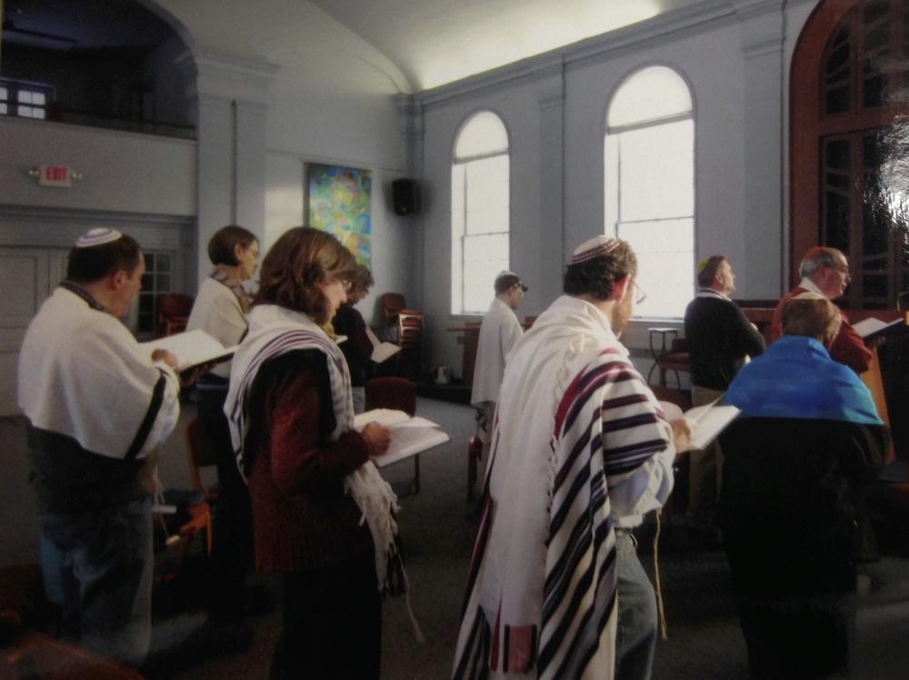Members in prayer service