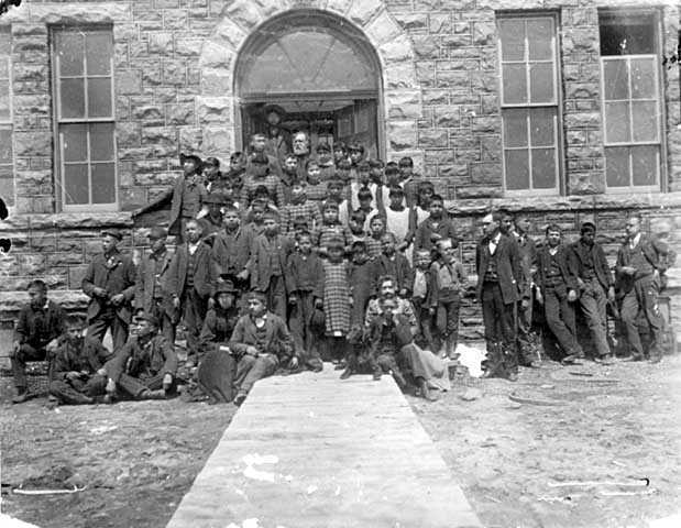 Student in Front of Pipestone Indian Training School Building in 1893