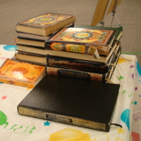 Photograph of stack of Qur'ans