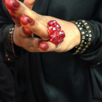 Wedding henna (red fingertip close-up)
