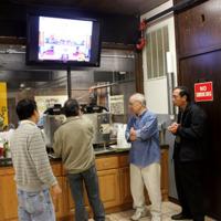 Temple Visitors Partake in Tea