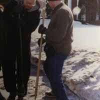 Members shovel sidewalk in front of synagogue